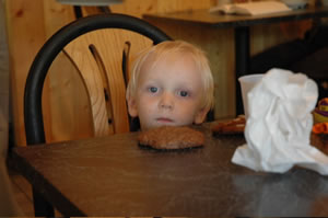 Owen and a cookie. photo by Stephen Howe